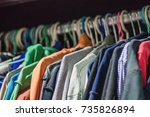 many man's clothes in wardrobe  ... | Shutterstock . vector #735826894