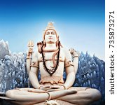 Small photo of Lord Shiva big statue sitting in lotus pose with trident in Murugeshpalya Temple in Bangalore, India. This Shiva Statue is highest in the world.