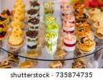 dessert table for a party.... | Shutterstock . vector #735874735
