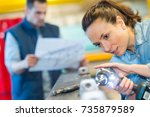 beautiful female at work using... | Shutterstock . vector #735879589