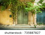 front of the old yellow... | Shutterstock . vector #735887827