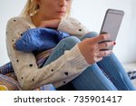 girl using phone seated on the... | Shutterstock . vector #735901417