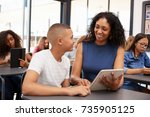teacher helping teenage... | Shutterstock . vector #735905125