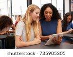 teacher helps blonde teenage... | Shutterstock . vector #735905305