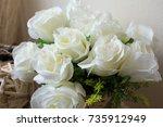 Stock photo close up basket of white roses 735912949