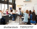 pupils raising hands in a high... | Shutterstock . vector #735915757