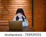 stressed asian woman using... | Shutterstock . vector #735929251