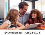 teacher and two pupils in... | Shutterstock . vector #735954175
