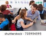 teacher and schoolgirl using... | Shutterstock . vector #735954595