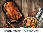 roast christmas duck with thyme ... | Shutterstock . vector #735965929