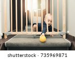 child playing behind safety... | Shutterstock . vector #735969871