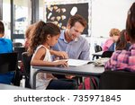 teacher working with young... | Shutterstock . vector #735971845