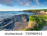 the beach at trevone bay near... | Shutterstock . vector #735980911