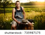 young man potter making ceramic ... | Shutterstock . vector #735987175
