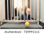 child throwing ball away... | Shutterstock . vector #735991111