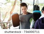 asian handsome sportman who has ... | Shutterstock . vector #736000711