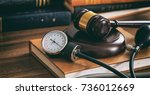 law gavel and a blood pressure... | Shutterstock . vector #736012669
