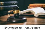 law judge gavel on a wooden... | Shutterstock . vector #736014895
