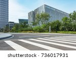 empty road with modern... | Shutterstock . vector #736017931