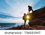 young asian couple climbing up... | Shutterstock . vector #736031947