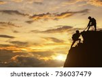 male and female hikers climbing ... | Shutterstock . vector #736037479