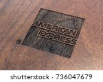Small photo of HONG KONG, HONG KONG – OCTOBER 10 2017: American Express logo on display at the AMEX Centurion Lounge at Hong Kong International Airport, set on a wooden background.