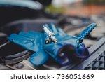 spark plug. car candles lie on... | Shutterstock . vector #736051669