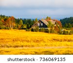wooden hut in jizerka village.... | Shutterstock . vector #736069135