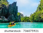 kayaks in the big lagoon with... | Shutterstock . vector #736075921