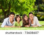 family lying down in the park | Shutterstock . vector #73608607