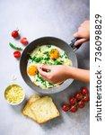 girl hands above frying pan... | Shutterstock . vector #736098829