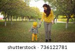 positive autumn. mom and little ... | Shutterstock . vector #736122781