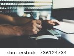 close up photo of male hands... | Shutterstock . vector #736124734