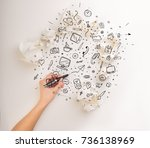 female hand next to a few... | Shutterstock . vector #736138969