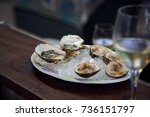 oysters on ice with a glass of... | Shutterstock . vector #736151797