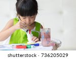 asian girl painted on plaster... | Shutterstock . vector #736205029