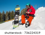 snowboarder sitting in the snow ... | Shutterstock . vector #736224319