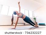 slim woman in side plank pose... | Shutterstock . vector #736232227