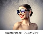 funny woman with sunglasses | Shutterstock . vector #73624924