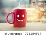 Red Mug Of Coffee With A Happy...