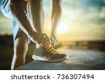 close up shot of runner's shoes.... | Shutterstock . vector #736307494