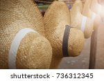straw hats with ribbons hanging ... | Shutterstock . vector #736312345