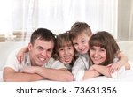 young happy family playing... | Shutterstock . vector #73631356