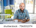 man drink coffee and work on... | Shutterstock . vector #736331374