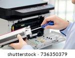man repairing toner for laser... | Shutterstock . vector #736350379