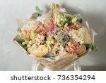 flower composition on a gray... | Shutterstock . vector #736354294