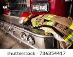Firefighter Gear On Truck Bumper