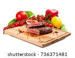 grilled steak on a cutting... | Shutterstock . vector #736371481