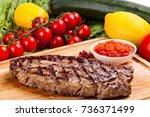 grilled steak on a cutting... | Shutterstock . vector #736371499