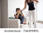 woman scolding her son at home. ... | Shutterstock . vector #736399891